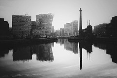 Canning Dock (Leirinmore) Tags: city morning winter bw white black reflection building water monochrome skyline liverpool docks march fujifilm mersey regeneration merseyside xt1