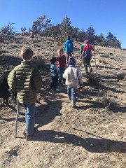 clean air kids hiking up hogback