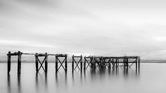 Aberdour Pier (Paul S Ewing) Tags: blackandwhite bw reflection canon mono pier sticks high key calm simple lightroom aberdour