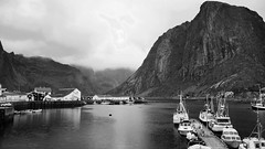 Fjords deep and mountains high - bw (lunaryuna (off to Iceland for 2 weeks)) Tags: sky bw panorama mountains water monochrome weather norway clouds marina landscape boats coast blackwhite harbour overcast fjord lunaryuna lofotenislands lowcloud hamnoy fishermenhuts lightmood lofotenwall lofotenarchipelago