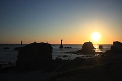 Phare de Nividic (Ingrid) Tags: light sea cloud sun mer island soleil contraste nuages couch le