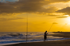 Sunset fisherman. (nevadoyerupaja) Tags: ocean sea cliff usa cloud sunlight beach coast fishing fisherman surf dusk kauai napali