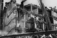 within reach (jeff-tidwell) Tags: street city blackandwhite buildings crane destruction demolition
