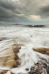 Low Hauxley - Incoming (mattwalkerncl) Tags: england cloud seascape water sunrise canon landscape eos rocks slow full northumberland coastal lee frame shutter manfrotto 6d lowhauxley