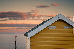 (Claire Hutton) Tags: sea christchurch summer colour beach water yellow clouds coast seaside spring triangle pastel huts coastal beachhut groyne triangular steamerpoint friarscliff sonyrx100ii