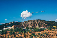 Middle distance runner. (achterbahnmdchen) Tags: blue sky brown white house mountain nature clouds crane earth hill achterbahnmdchen