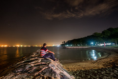 A Pause From Monotony (arnabjosephite) Tags: ocean blue light sea sky people reflection beach yellow clouds port stars sand singapore ships