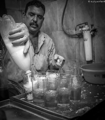 Milk sarbath man! (cheruvadiyan) Tags: bw milk fuji drink kerala fujifilm calicut kozhikode sarbath x100t