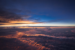 mile high sunrise (almostsummersky) Tags: above morning travel pink blue winter red sky orange sun clouds plane sunrise airplane early fly flying atl air horizon flight delta syr