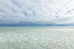 Lake Michigan in Winter (Darren Hsu) Tags: county winter sky lake snow color ice water strange clouds landscape illinois university angle outdoor michigan wide cook northwestern evanston t116
