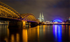 Cologne / Germany 2015 (zilverbat.) Tags: world city longexposure nightphotography travel bridge wallpaper tourism water architecture night reflections germany dark deutschland photography lights exposure nightlights nightshot calendar cathedral image dom postcard cologne railway kln visit stadt bookcover colourful altstadt global merkel duitsland keulen brucke reflectie angelamerkel spoorbrug citytrip avondfotografie tripadvisor citybynight zilverbat longexposurebynight elvinhagekpnplanetnl spoorbrucke