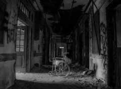 (Fatigued_23) Tags: urban blackandwhite abandoned decay wheelchair hallway asylum dilapidation abandonment dilapidated urbanexploring mentalinstitute