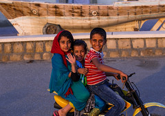 children riding a motorbike, Qeshm Island, Laft, Iran (Eric Lafforgue) Tags: girls boy portrait people playing motion girl childhood bike bicycle horizontal kids children outdoors photography bicycling amusement persian movement asia day iran profile joy young sunny persia motorbike riding transportation biking moto leisure recreation iranian activity sideview humanbeing middleeastern persiangulf headwear 3people qeshmisland chador threepeople laft hormozgan lookingatcamera  bandari   iro straitofhormuz  colourpicture  iran034i8220