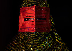 a bandari woman wearing a traditional mask called the burqa, Hormozgan, Minab, Iran (Eric Lafforgue) Tags: red portrait people woman beauty horizontal golden persian clothing eyes asia veil mask iran muslim islam religion hijab culture persia headshot hidden indoors covered iranian adultsonly oneperson traditionaldress burqa customs middleeastern frontview sunni burka chador 20sadult youngadultwoman balouch darkbackground hormozgan onewomanonly lookingatcamera burqua  bandari  1people  iro thursdaymarket  minab colourpicture  borqe panjshambebazar boregheh irandsc06719