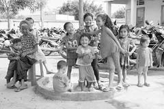 (kuuan) Tags: grandma bw kids fun village play grandmother vietnam grandson grandchild tenderness vilage takecare