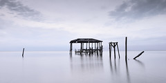 Isolation (santo commarato) Tags: longexposure travel seascape water rotting pier travels nikon cloudy decay urbandecay dreamy pilings traveling isolated dreamscape d800 waterscape waterreflections travelphotography oldpier santocommarato