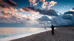 fishing in relax (Marco Brunetti) Tags: sunset sea seascape fishing fisherman mare pentax sicily giardininaxos pentaxk30 mefotoroadtrip hdpentaxda1685