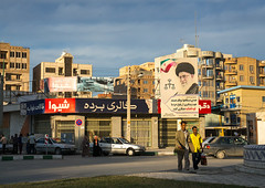 propaganda sign with khameini portrait in the street, Hormozgan, Bandar Abbas, Iran (Eric Lafforgue) Tags: road street city portrait people signs men cars sign horizontal poster outdoors town asia iran propaganda muslim islam president persia posters billboards leader groupofpeople adultsonly islamic middleeastern persiangulf bandarabbas hormozgan  fulllenght  5people  iro  unrecognizableperson colourpicture  irandsc06294