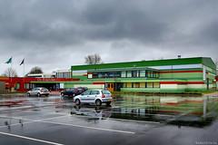 De Binding (Emil de Jong - Kijklens) Tags: rain architecture clouds parking wolken regen architectuur refelection wolk reflectie sporthal oudepekela oostgroningen sportaccomodatie groningenfunctiesdorpshuisbibliotheek onderdakverenigingen parkeerterreun