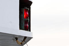 Red Lantern (brucetopher) Tags: light red white lamp bulb port boat ship glow shine electronics boating highkey lantern left redlight contemplative navigation navigational navigationlight