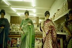 sari glow (troutfactory) Tags: 2001 film berkeley lomography mannequins availablelight archive lomolca storefront sanfranciscobayarea analogue kodakmax400 sari fluorescentlight saristore