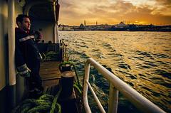 Patience (Melissa Maples) Tags: sunset man water ferry turkey evening boat nikon asia sundown dusk trkiye sigma istanbul worker sailor 1020mm strait bosphorus turk  karaky   f456 hsm  1020mmf456 d5100
