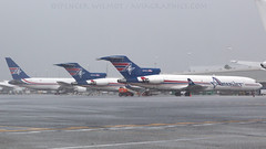 Amerijet Aircraft During A Rain Storm. (spencer.wilmot) Tags: wet water rain plane airplane grey airport ramp florida miami aircraft aviation jet cargo apron mia boeing m6 freight airliner freighter 727 jetliner trijet b727 ajt airside kmia amerijet ttail 727f n495aj