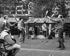 Juggle (Oliver Leveritt) Tags: newyorkcity blackandwhite newyork monochrome manhattan juggling juggler bryantpark afsnikkor2470mmf28ged oliverleverittphotography nikond7100