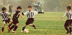 Soccer downpour (mickeyboy2008) Tags: sports rain kids ball athletics soccer athlete futebol