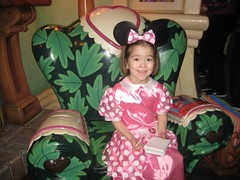 Sitting in Minnie's chair (Sim-tov) Tags: california vacation portrait holiday disneyland chanukah dec surprise anaheim noa 2015
