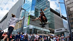 Downtown daredevil (dVaffection) Tags: city urban vancouver danger fire downtown knives daredevil stunt knivesthrowing