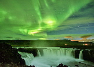 The Dance of the Aurora and the Waterfall