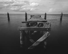 Old Piers (GOJR.) Tags: longexposure analog mediumformat mono pier blackwhite antique nd 6x7 mamiyarb67pros hoyandx400 mamiyasekor50mmf45 fujifilmneopanacross100