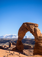 Delicate Arch (Robby Armentano) Tags: road trip brown mountain snow southwest robert utah spring ut break arch desert zoom parks arches olympus bowl tourist rob national american pro moab 16 mm delicate region capped robby em1 2016 1240 armentano