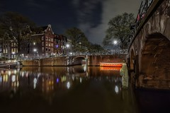 Red Boat (karinavera) Tags: street city longexposure travel bridge red urban amsterdam night boat canals exploration nikond5300