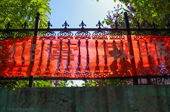 Red_Banner_Shadows_Tangshan_China_2015_ Melissa Donaghue-9189 (daisyvisionxxx) Tags: china blue trees red summer sky green wall fence asia iron pentax banner cement august bluesky hebei  ricoh peoplesrepublicofchina 2015  tangshan    hebeiprovince  8032015 tangshancity pentaxk50 melissadonaghue