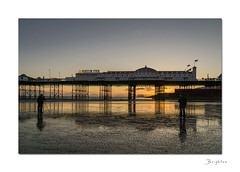 Low tide on Brighton beach (hehaden (away for a week)) Tags: sunset sea beach sussex pier sand brighton photographers tripods brightonpier togs palacepier