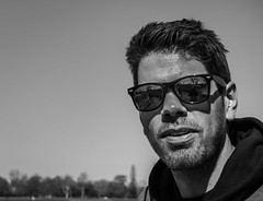 Sunglasses Series III. (neerod81) Tags: portrait bw man monochrome sunglasses reflections outside candid surprised mann coincidence jogger sonnenbrille spiegelungen berrascht chancemeeting someoneiknowabit zuflligeswiedersehen