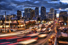 Urban Suburban (TIA International Photography) Tags: road street city longexposure blue urban motion blur car retail skyline buildings shopping landscape washington construction energy downtown commerce cityscape traffic suburbia overcast headquarters business busy lamppost rush hour commute bauer electricity pokemon vehicle intersection suburb eddie drugstore tmobile rei bellevue expedia bartell