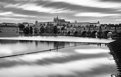 Prague (mclcbooks) Tags: longexposure sunset blackandwhite water monochrome clouds reflections landscape evening cityscape prague praha praskhrad le czechrepublic charlesbridge praguecastle karlvmost vltavariver katedrlasvathovta