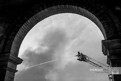 Front Street Fire- Georgetown, 2013 (Alan Sherlock) Tags: sky bw cloud white black water monochrome silhouette fire stream fighter smoke hose fireman ladder