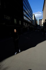 Street scenes (HKI DRFTR) Tags: portrait urban sunlight girl face contrast finland helsinki colours shadows snapshot streetphotography negativespace figure lone citycentre emptiness decisivemoment obscure deepshadows harshsun