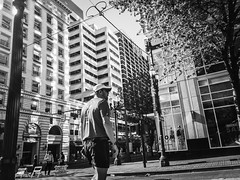 Light Refracted (TMimages PDX) Tags: road street city people urban blackandwhite monochrome buildings portland geotagged photography photo image streetphotography streetscene sidewalk photograph pedestrians pacificnorthwest avenue vignette fineartphotography iphoneography
