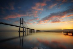 El gran A-Tajo! (Blai Figueras) Tags: longexposure bridge sea sky costa sun seascape beach portugal water río sunrise reflections river landscape puente coast mar seaside agua flickr lisboa horizon atmosphere playa paisaje ponte amanecer le tajo silkeffect