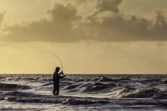 The Fly Fisherman At Sunrise (Mabry Campbell) Tags: morning usa seascape man gulfofmexico water silhouette sunrise person photography dawn fly us photo fishing fisherman surf texas photographer gulf image fav50 tx horizon unitedstatesofamerica july fav20 photograph rosemary flyfisherman 100 flyfishing freeport fav30 surffishing wading 2012 fineartphotography bending f40 waterscape selenium surfside oneman angler 200mm architecturalphotography surfsidebeach colorimage commercialphotography fav10 editorialphotography fav40 fav60 architecturephotography ef200mmf28liiusm fav80 brazoriacounty fav70 wadefishing cirve fineartphotographer houstonphotographer backcast ¹⁄₆₄₀₀sec mabrycampbell july62012 201207062115
