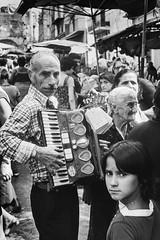 Herculaneum, Italy - Sept 1977 (johnjackson808) Tags: people blackandwhite bw italy musician monochrome market trix streetphotography busker 1970s accordian 1977 ercolano herculaneum leicam3