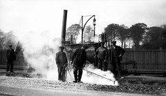 Laying Tramlines (Dundee City Archives) Tags: road old 1920s horse track workmen photos dundee roadworks machine granite drawn reserved boiler tar tramlines repairs laying spreader setts cityengineer craigiedrive olddundeephotos