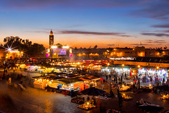 Marrakech Twilight (sampollittphoto) Tags: africa travel sunset sky people orange tourism clouds square twilight colours market outdoor dusk stall mosque morocco marrakech medina destination marrakesh jemaa djemaaelfna lakoutoubia