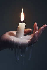 Holding a candle on a dark background. (croche3) Tags: light hot dark fire warm candle shine hand bright skin background surreal flame burn heat wax melt concept dim carry hold wick