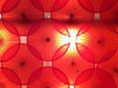 umbrella sunset (normalniemilosc) Tags: red amsterdam lights restaurant design colours interior ceiling umbrellas